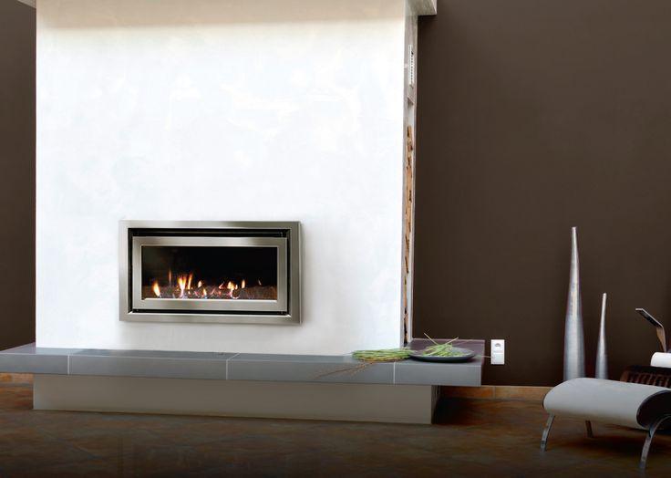 Escea DL850 with a titanium silver Quadrato fascia with a log fuel bed.  www.escea.com