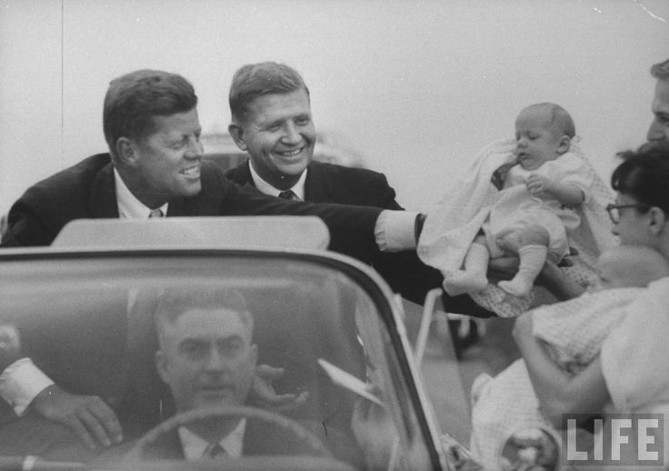 John F. Kennedy (R) and Gov. Terry Sanford (Center) campaigning. Location:	NC, US Date taken:	September 1960 Photographer:	Walter Sanders