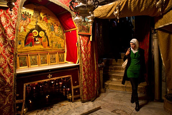 A Palestinian Muslim woman visits the Grotto of the Church of the Nativity, believed by many to be the birthplace of Jesus Christ, in the West Bank town of Bethlehem. religious appritiation and diversity does exist