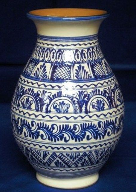 Handmade ceramic vase with traditional Hungarian motives on it.
