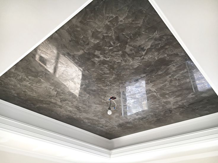 Master bedroom ceiling finished in venetian plaster