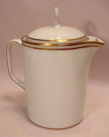 """Tiffany & Co. Limoges, France Teapot Creamer CHASTAGNER circa 1950s. The mark dates these to the 1950s by Chastagner China, Limoges, France for Tiffany & Co. These were made expressly for Merrill Lynch.It measures about 5-5/8"""" high with the cover and 4-7/8"""" across from handle to spout."""