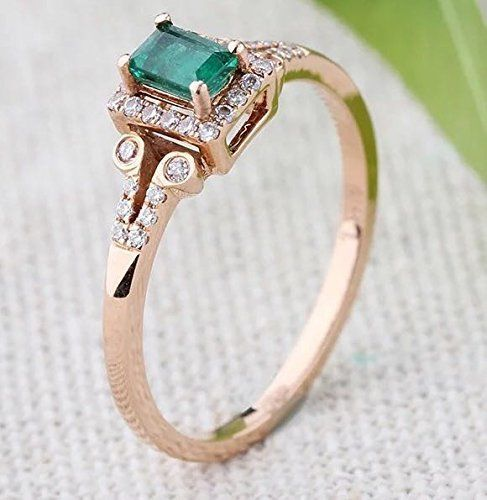 Emerald engagement ring with diamond accents, $799. A great non-traditional engagement ring for those who love colorful jewelry. | Budget Friendly Engagement Rings Under $1000