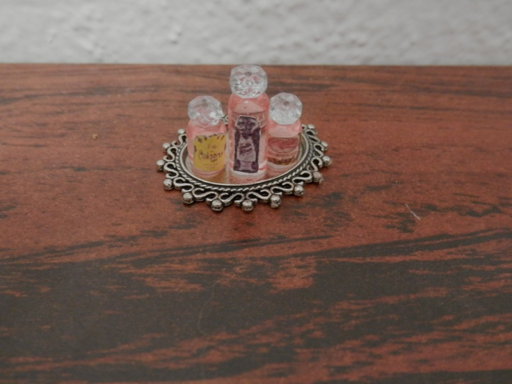 Three Pink Perfume Bottles On Silver Tray. $5.00, via Etsy.