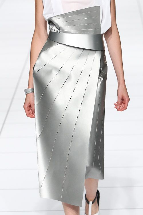 Silver leather skirt with sharp angles, crisp folds & perforated line patterns; architectural fashion details // Issey Miyake ss14