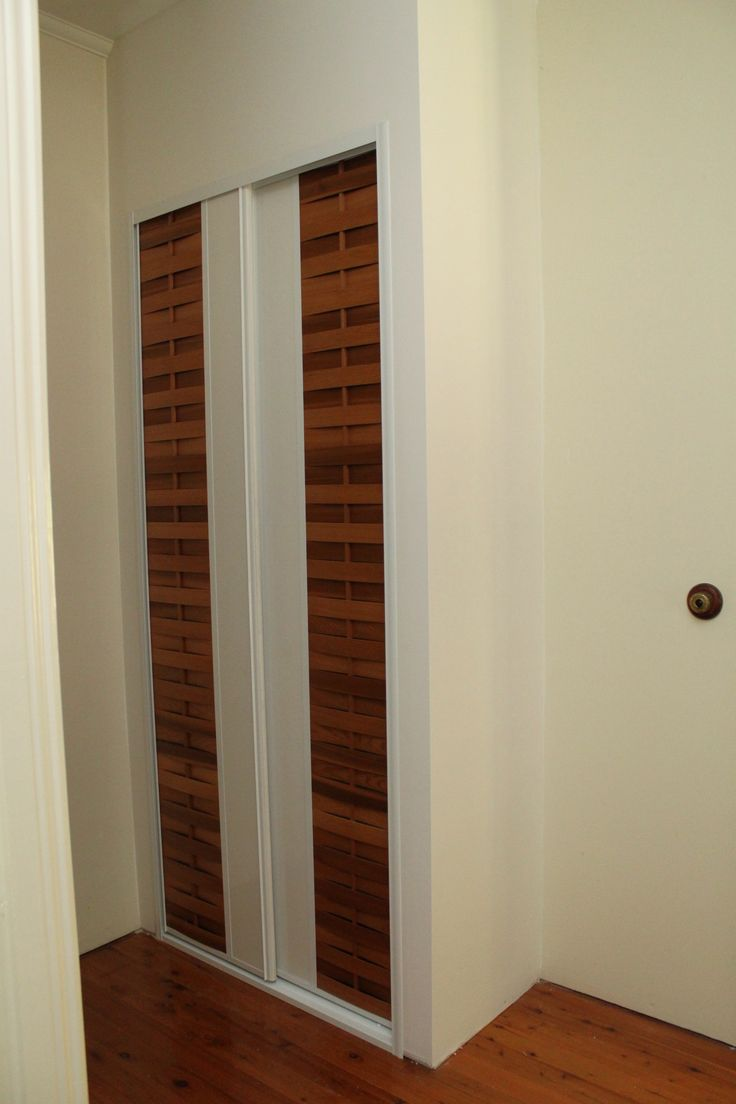 linen cupboard doors with the woven sukiya slats to the outside shown adjacent with the