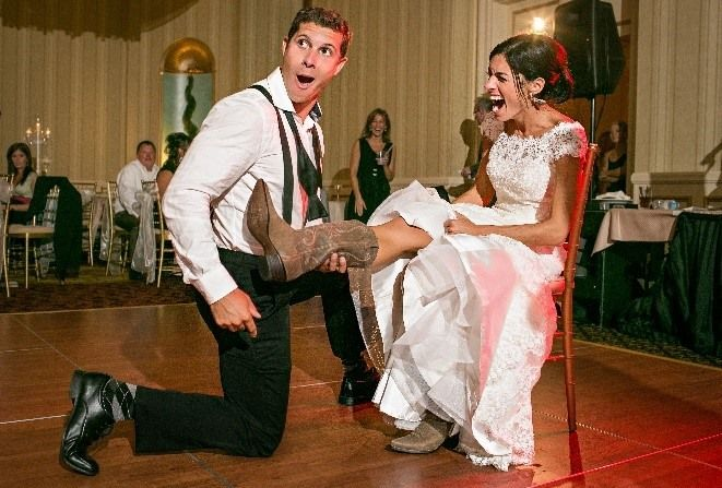 Have some fun with your garter toss. Check out the cowboy boots!  We can assist you in choosing the perfect song for this moment: http://www.adagiodj.com/  #gartertoss #garter #wedding #weddingsong #weddingmusic #weddingdj #dj #adagiodjay #saintpaulwedding #saintpualdj #weddingfun #fun #cowboyboots #cowboy  Photo Credit: erin johnson photography http://www.erinjohnsonphotoblog.com/