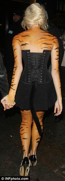 Looking grrrreaaat: Pixie Lott enjoys a night out at Boujis nightclub in London dressed as a tiger @Sera Brown