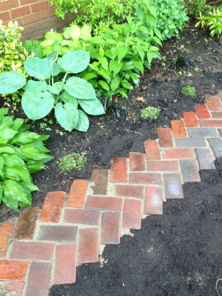De 25 b sta id erna om flower bed borders hittar du p for Brick garden edging ideas