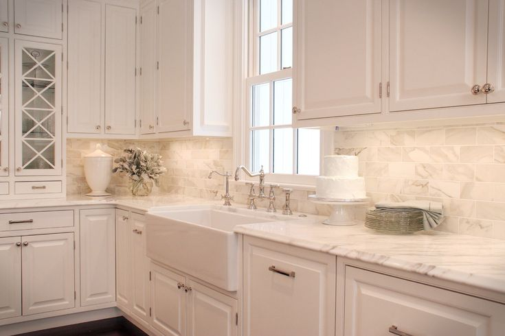 Gorgeous calacatta marble in Kitchen Traditional with Marble Backsplash next to…