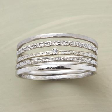 One sweet diamond sparks a set of five 14kt white gold rings, each wisp of a band exhibiting its own characteristics. Handcrafted in USA. Designed by Victoria Cunningham. Whole sizes 5 to 8.
