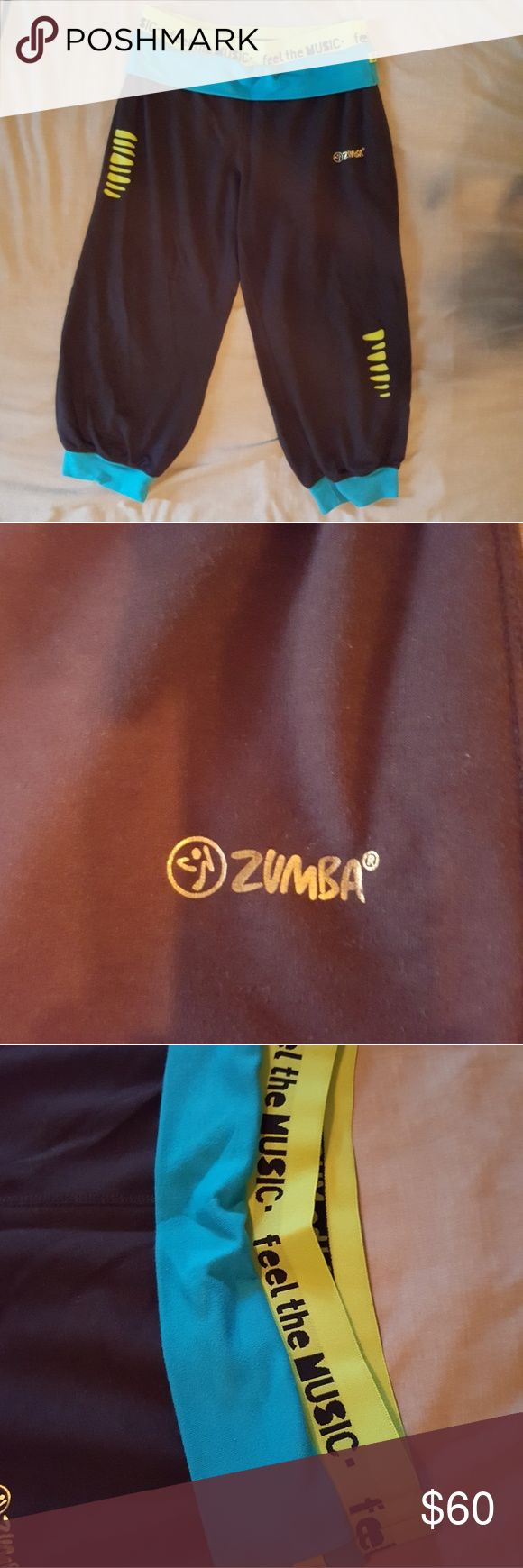 "Zumba Black & Blue with Neon Yellow Pants Zumba Black & Blue with Neon Yellow Pants - Super comfy! - BRAND NEW! NEVER WORN! - Neon Blue & Neon Yellow details with ""Feel The Music"" - Knee High.  - Stretchy belt. Zumba Fitness Pants"