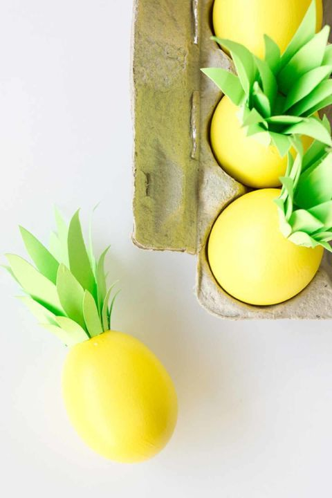 Tropical Eggs: Make your holiday table pop with the addition of these pineapple-inspired eggs. Click through to discover more DIY decorating ideas for your Easter eggs.