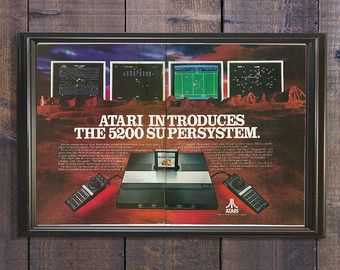 #Atari Video Games Sign | Atari 5200 Model | Game Room Poster | Man Cave Wall Art | Girl Gamer Gift | 1980s Retro Vibe | Magenta Home Decor  D A T E : 1982  S I Z E : 10.75 x 8.5 inches  R E A D S : Why atari is #1.  U S E S : This vintage ad would be great as a unique home decor piece for a fun frame, but could also be used for scrapbooking, upcycling, mixed media projects, decoupage DIY, adding to digital graphics collection, or even as something creative like wrapping paper or clip art. #gami