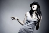 Dance : Emotional portrait of beautiful girl in hat