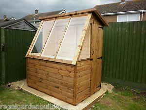 6x4 WOODEN POTTING SHED - next to a 6x8 Shed...