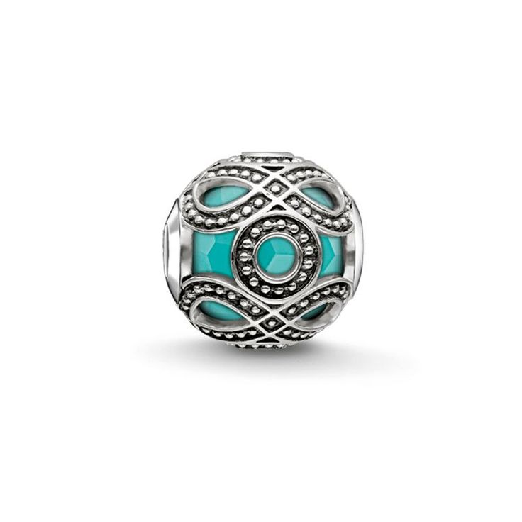 THOMAS SABO Bead from the Sterling Silver Collection. With the turquoise-coloured, culturally inspired Bead, a web of blackened 925 Sterling silver subtly encompasses a core of imitation facetted turquoise that is said to provide self-confidence and energy. [Artikeltabelle]Category:Bead Motive:turquoise ethnic Material:925 sterling silver, blackened Stones:simulated turquoise Measurements:width approx. 1,1 cm (0,43 Inch) Itemnumber:K0209-878-17[/Artikeltabelle]