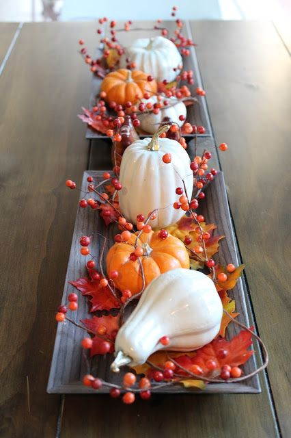 Simple fall table centerpiece decoration! Using inexpensive candle trays from Michaels, leaves, and a simple fall DIY! Create faux ceramic pumpkins and gourds using Dollar Tree foam veggies!