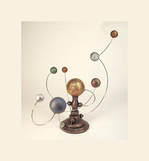 An old-fashioned orrery.  Useful?  Eh, maybe not.  Totally perfect for a library or private study?  Absolutely.