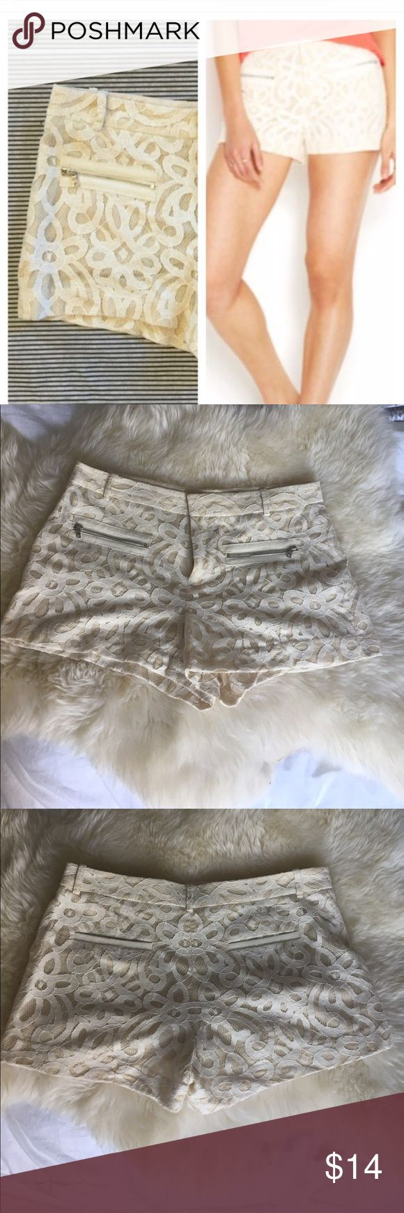 Rachel Roy cream lace shorts Dressy lace shorts by Rachel Roy. Silver zip front pockets. EUC, worn once on vacation. Measures 12 inches long laying flat, 17 inches wide laying flat. RACHEL Rachel Roy Shorts