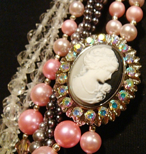 I adore this vintage necklace!! Beautiful pink and gray and the beautiful cameo... handmade too! I found it at Vintelgance.