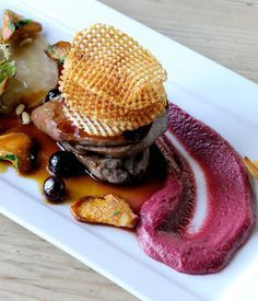 Wood pigeon with blueberry jus, beetroot purée and potato crisps - This Mark Dodson wood pigeon recipe is a modern British classic. Breast of wood pigeon is topped with a potato crisp and drizzled with a blueberry jus and beetroot purée - a dish which looks as good as it tastes.