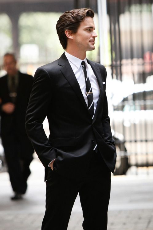 My husband wants to dress like Matt Bomer in White Collar.  I think I will let him :) A well-tailored suit with a well-cut shirt and a slender tie.
