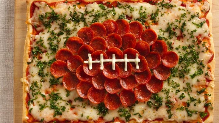 This cheesy pizza made using Pillsbury® pizza crust and decorated with pepperoni is a perfect treat for the sport lovers - ready in just 30 minutes!