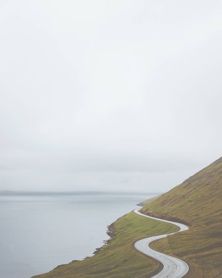 the road that leads from the airport on the Faroe Islands to the capital Tórshavn. Vágar, Faroe Islands