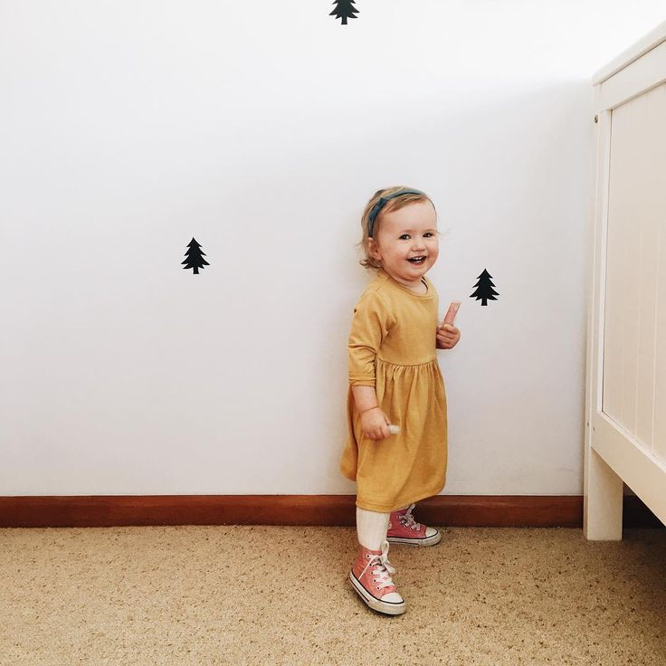 """Breony in her Baby York Little Miss Dress. 100% merino - handmade in NZ """"She already knows that this is the wall we stand in front of and say """"cheese""""  so darn cute watching her do this! • #thebreonydiaries"""" @thelovecollectivenz"""