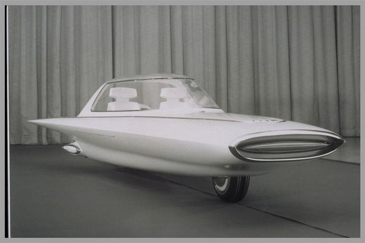 1961 Ford Gyron Concept - The Ford Gyron was a two-wheeled gyrocar which made its debut at the 1961 Detroit Motor Show. It was a concept car that had a very futuristic, two-wheeled design. It had a motorcycle-like design, with one wheel in the front and one in the rear. The vehicle was stabilized by gyroscopes. When the vehicle was at a stand-still, two small stabilizer legs appeared from the sides to add support.