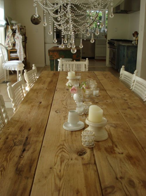 Wood table with white chairs & chandelier - Rachel Ashwell