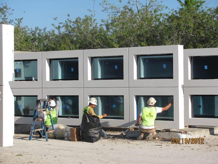 Precast concrete wall systems with pre installed windows for Precast concrete homes florida
