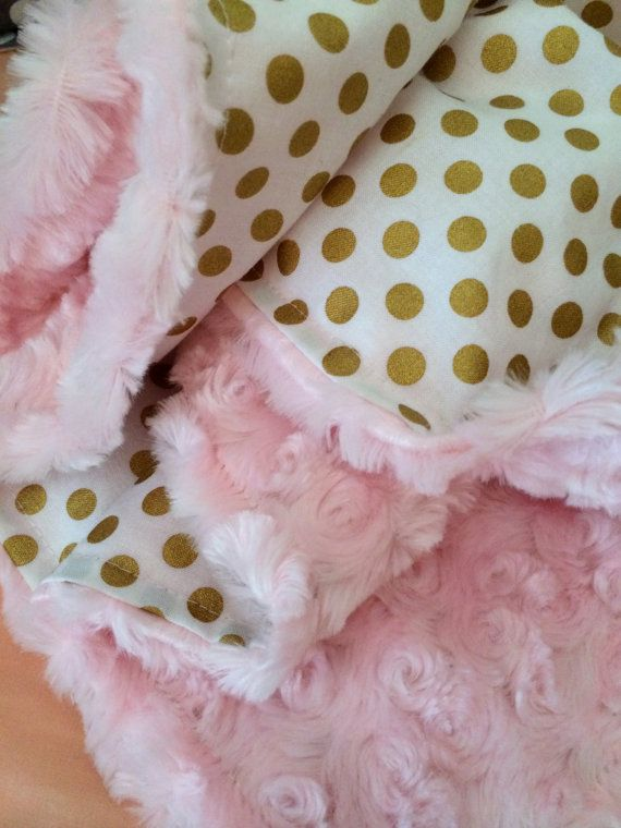 Robert Kaufmans designer spot on medium dot fabric makes up the front of this baby blanket. The back is a soft light pink swirl minky. This blanket