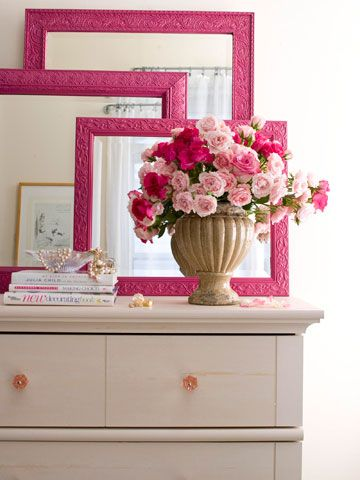 Painted framed mirrors layered on a dresser