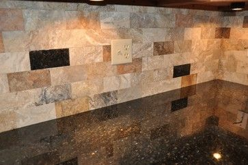 "Uba Tuba granite countertop with a Scabos tile backsplash cut into rectangular shapes from 12""x12"" tiles. The dark pieces are Uba Tuba tiles matching the granite countertop. For more information contact Supreme Surface, Inc. 317-865-0000."