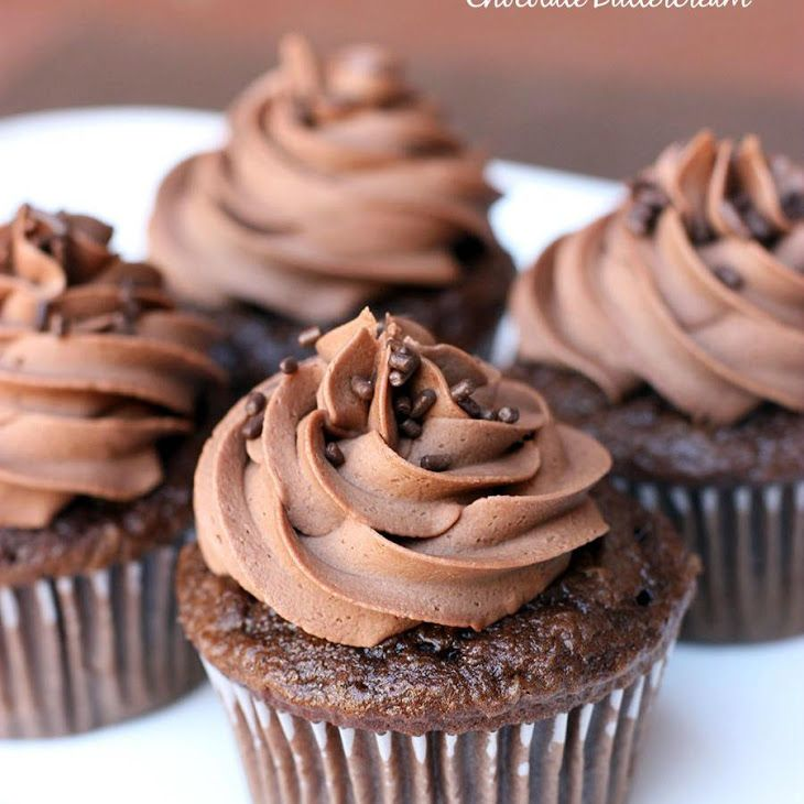 Chocolate Cupcakes with Chocolate Buttercream Frosting Recipe Desserts with cocoa powder, baking soda, boiling water, butter, vegetable oil, granulated sugar, vanilla extract, salt, large eggs, large egg yolks, heavy cream, all-purpose flour, butter, vanilla extract, unsweetened cocoa powder, milk, powdered sugar