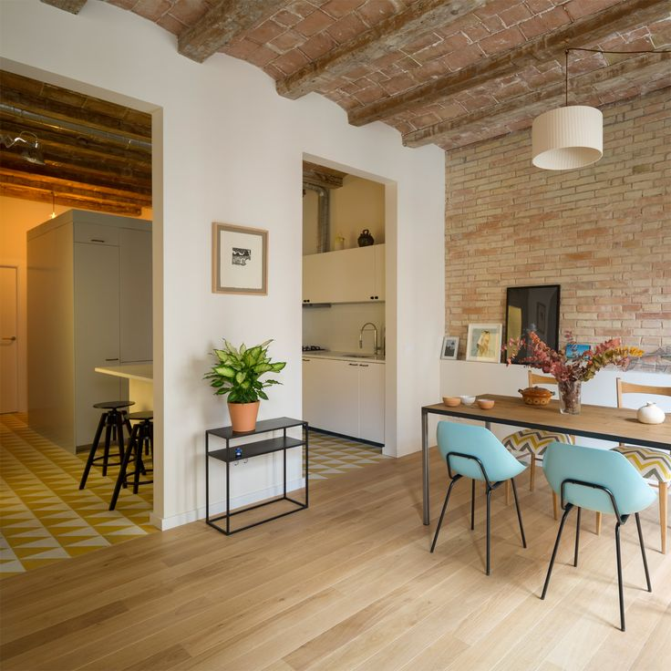 Nook Architects adds new openings and freestanding furniture to Barcelona apartment.