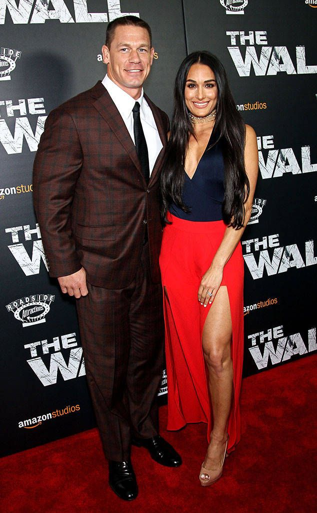 John Cena & Nikki Bella from The Big Picture: Today's Hot Photos  Lovebirds! The pair strike a pose on the red carpet during The Wall premiere in New York.