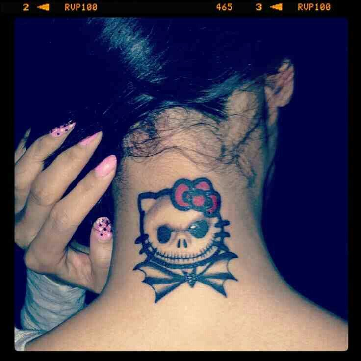 Jack Skellington / Hello Kitty tattoo... @angsnod Pretty sure I found our Breastie tattoo!!!  lol.