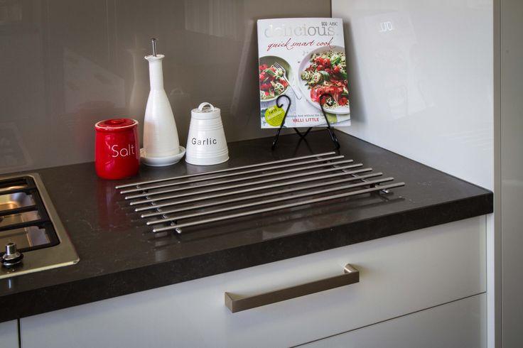 Modern kitchen. Red accessories. www.thekitchendesigncentre.com.au