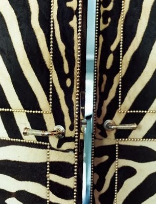 Zebra skin studded doors - bookmatched, of course.