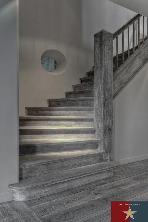 dark grey hardwood floors - love that its just so different! Maybe kitchen cabinets or bathroom???