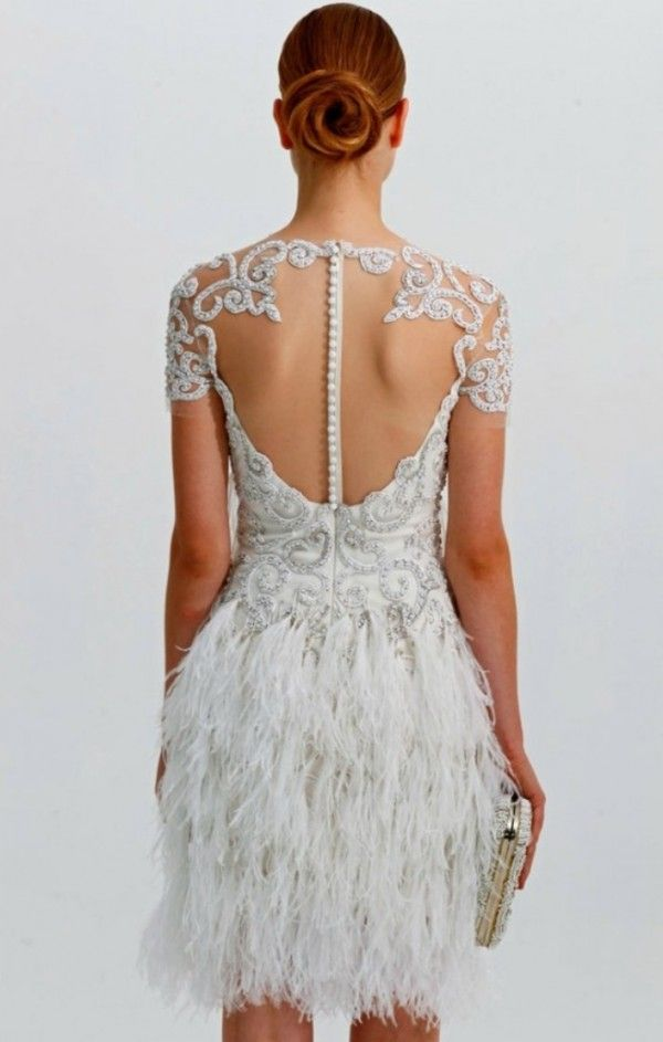 Gorgeous lace and button back details on this short wedding dress by Marchesa