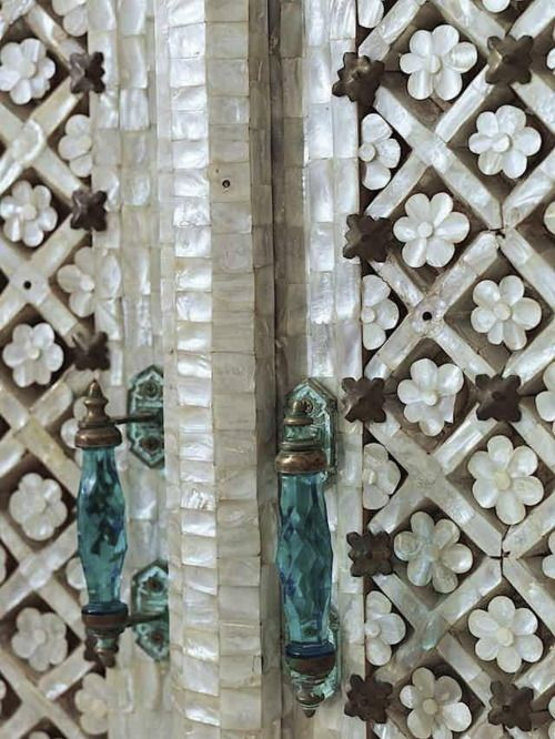 Close-up photo of the door detail. Careful mother of pearl inlay.  Very time consuming & glamorous!  Syrians and Indians excel at this kind of work.