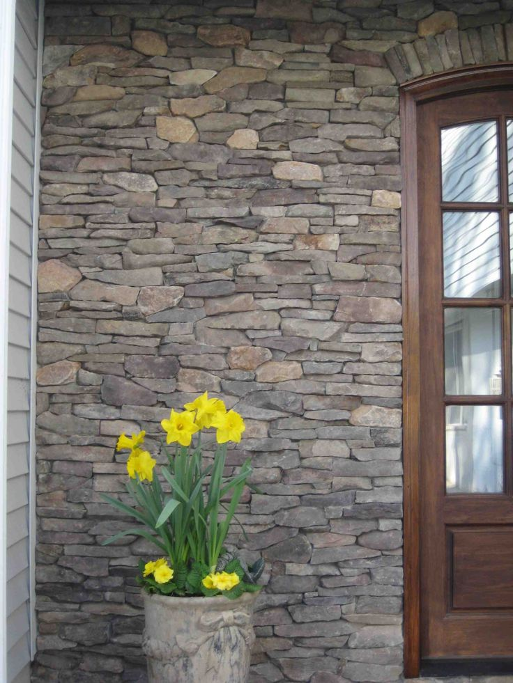 Martinsville Natural Thin Stone Veneer around door and on side gate wall