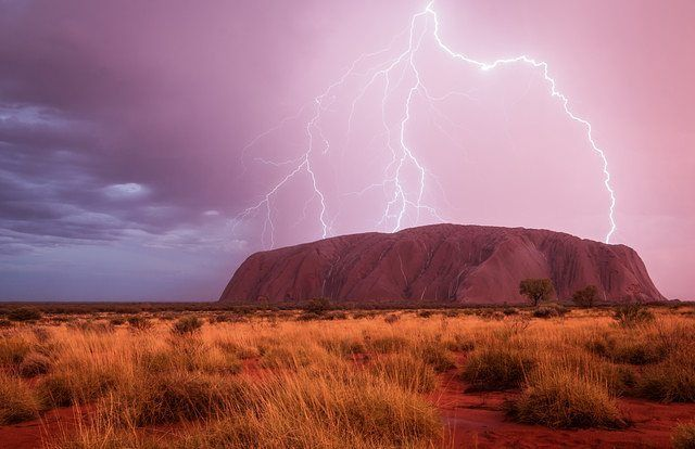 POWERED SIGHT by Christoph Schaarschmidt #Photocircle #naturephotography from #Australia #Uluru #rain #redcenter  #Anangu #Aboriginees #rock #KataTjuta #NationalPark #mountain #landscapephotography #travelphotography #lightning #thunderstorm #picoftheday  #Closethecircle - if you buy this photo Christoph Schaarschmidt and Photocircle #donate 9% to provide an oxygen concentrator for patients with #TB in #EastTimor