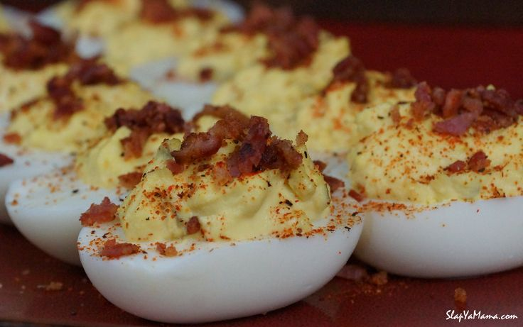 Slap Ya Mama Deviled Eggs Ingredients: 6 eggs, boiled, peeled & rinsed 2 slices bacon, cooked crispy & diced ¼ cup mayonnaise  1 ½ tsp sweet pickle relish 1 tsp Dijon mustard ¼ tsp Slap Ya Mama Pepper Sauce Slap Ya Mama Hot Blend Seasoning, to taste paprika, pinch for each egg Directions: With a... [Read More]