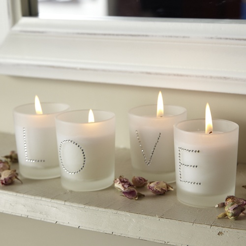 this cute but in clear candles on the cake table and spell out the bride and groom name