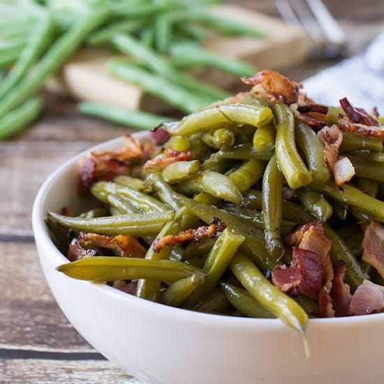 Southern-Style Green Beans are cooked long and slow until melt in your mouth tender. Flavored with lots of bacon.